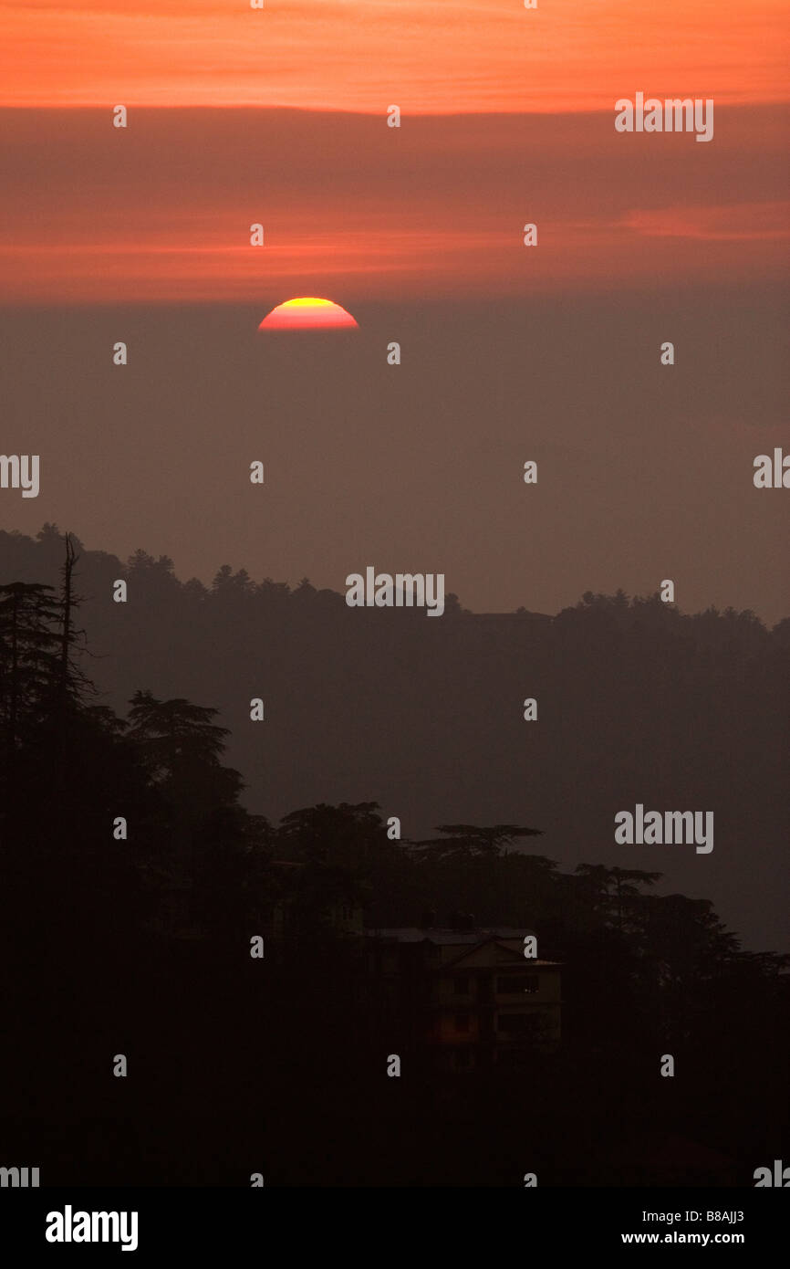 The sun sets over the valleys surrounding the north Indian town of Shimla. Stock Photo