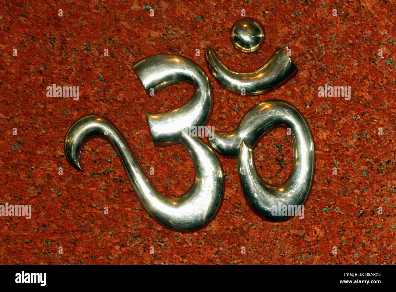 Om, an holy symbol, in a temple near Akluj, Maharashtra, India. - Stock Image