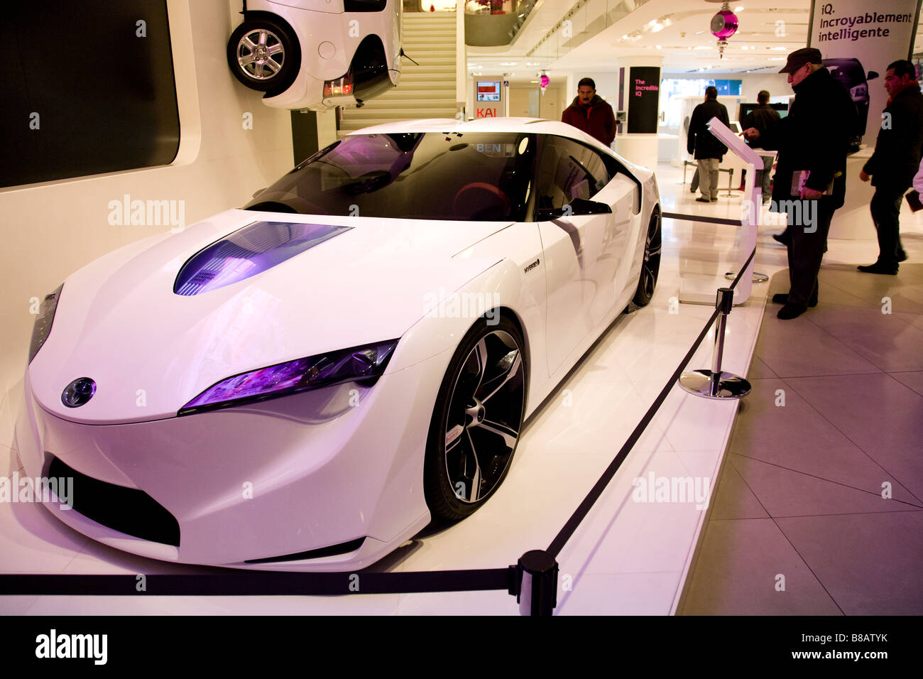 Onlookers Admire A Concept Car In A Showroom In Paris   Stock Image