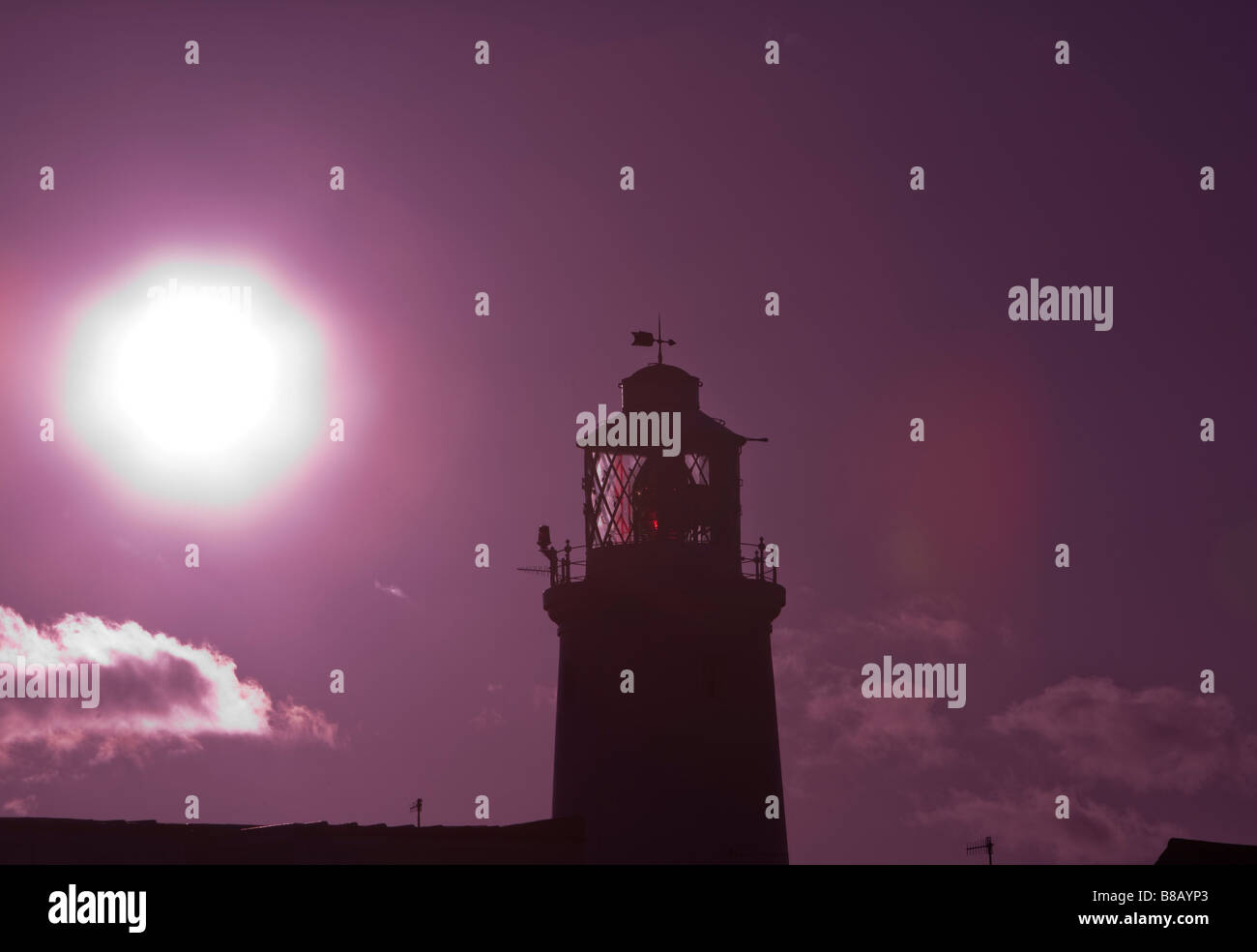 Southwold Lighthouse in magenta winter sunlight on the Suffolk Coast, space for text all around. Sky colour digitally - Stock Image
