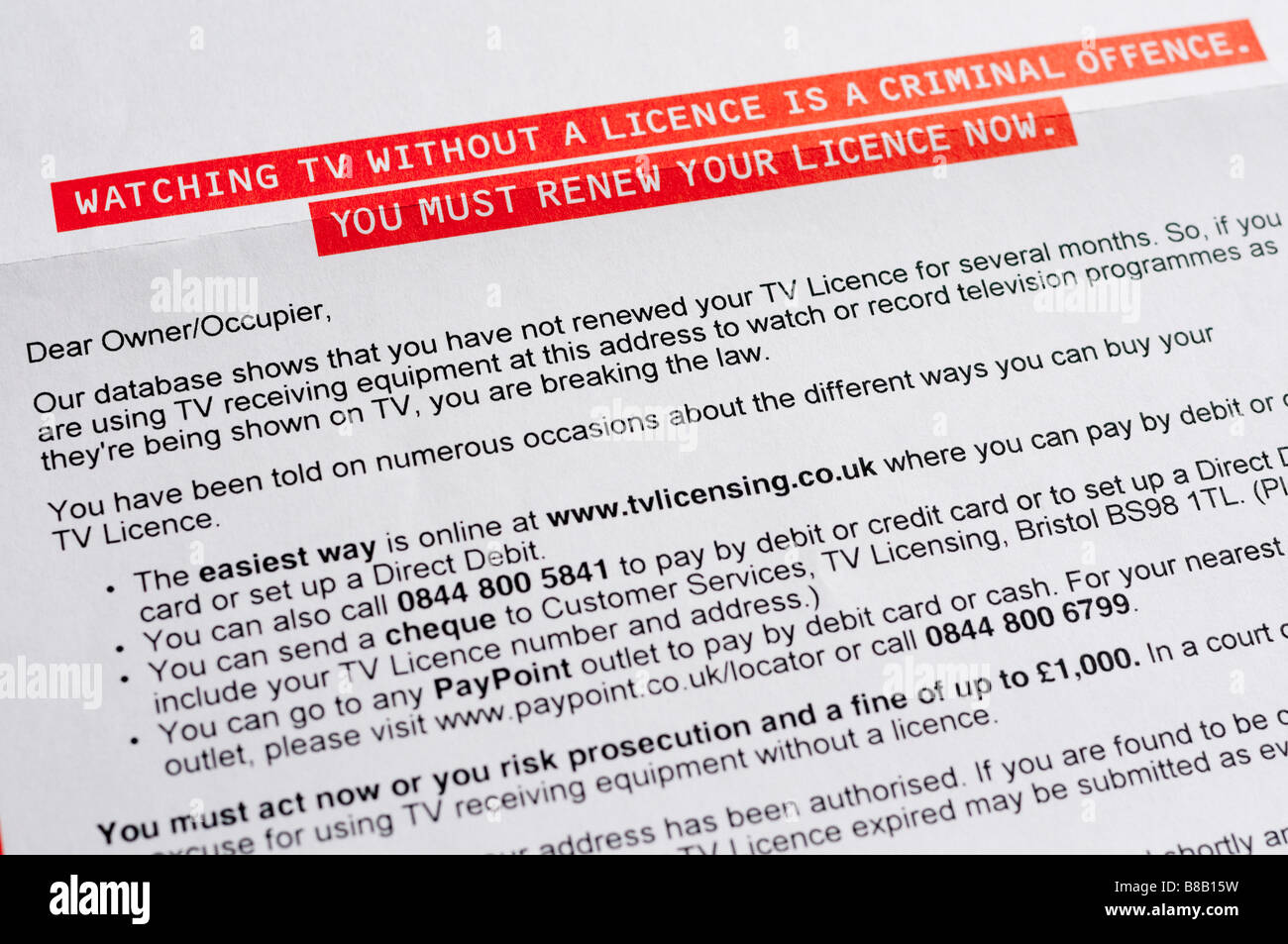 Letter from UK TV Licencing warning about criminal/legal proceedings if licence is not purchased. - Stock Image