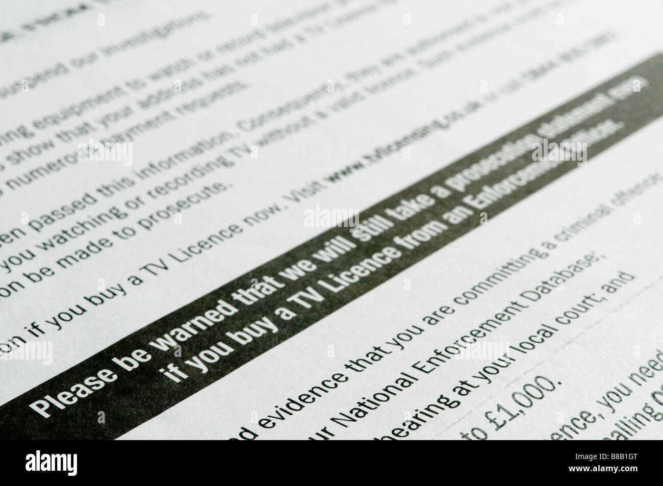 Letter from TV Licencing warning about criminal/legal proceedings if licence is not purchased. - Stock Image