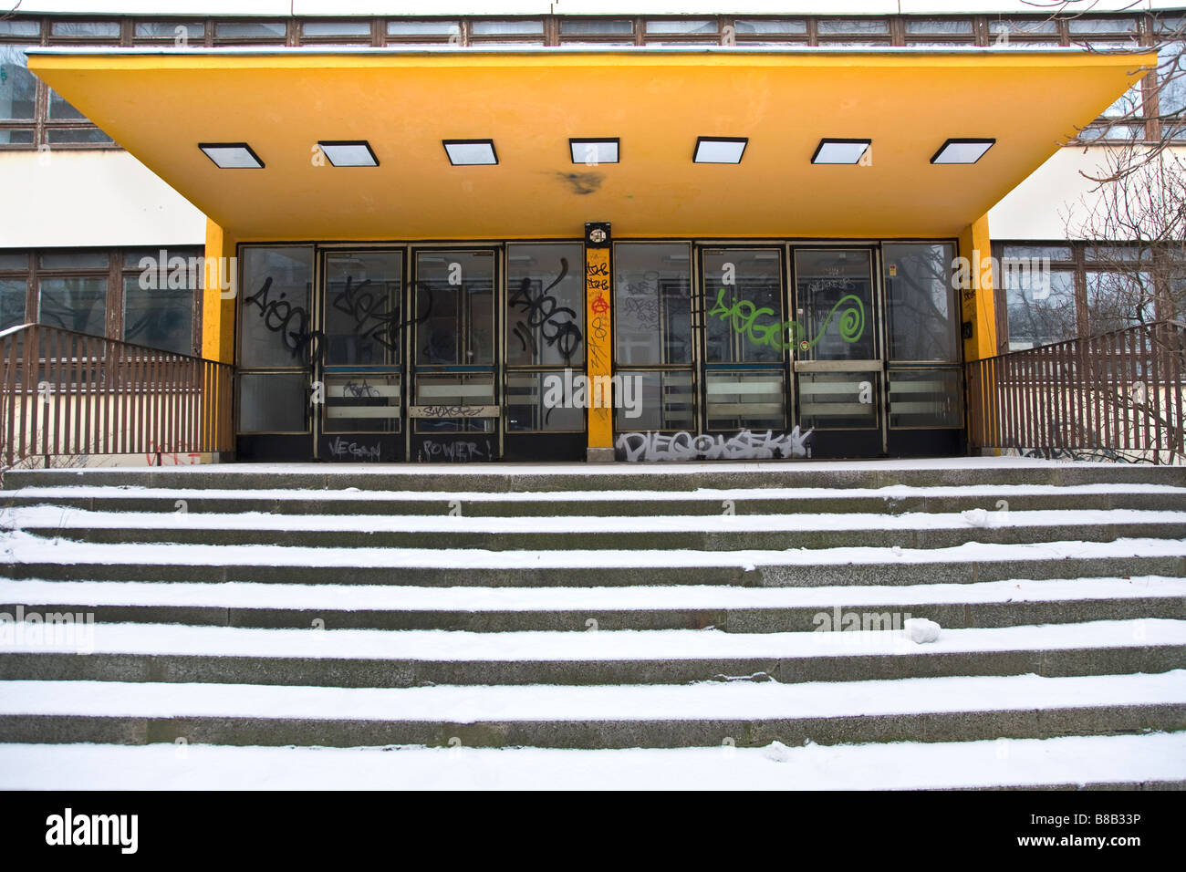 school steps covered in snow - Stock Image
