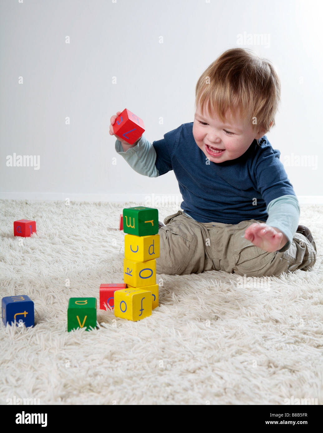 Baby boy playing with building blocks (with signed model release - available for commercial use) - Stock Image