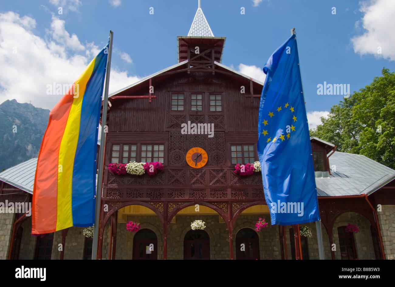Busteni, Romania, Oraseneasca Library, with Romanian and European Union flags - Stock Image