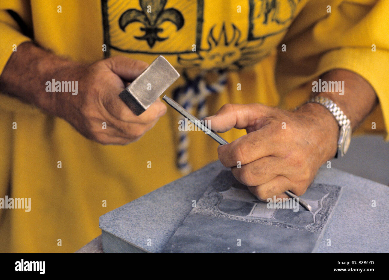 Hands of Scribe or Stone Carver, Man Dressed in Medieval Costume, Entrevaux Medieval Festival, Alpes-de-Haute-Provence, - Stock Image