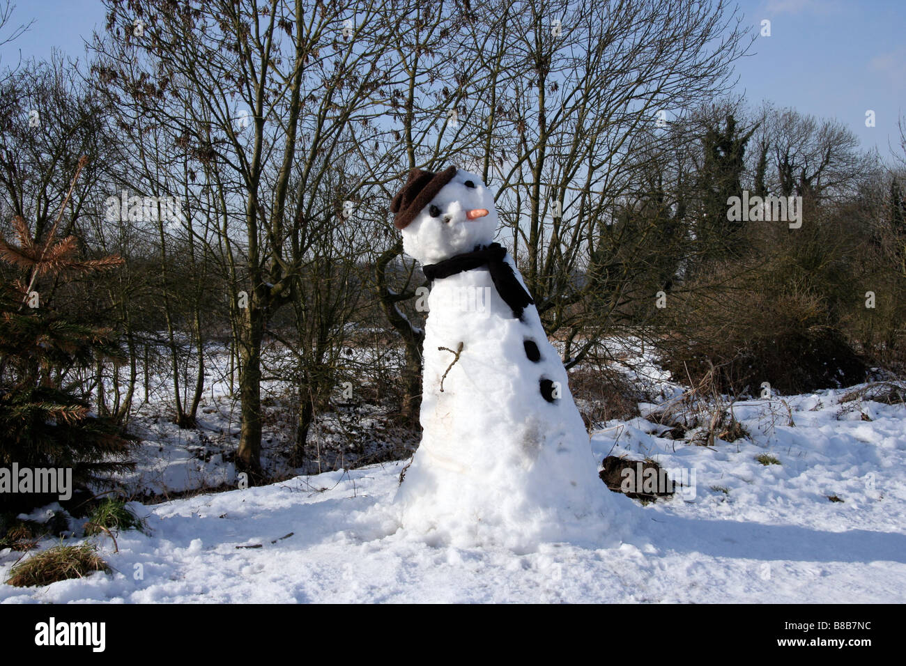 Snowman on a towpath - Stock Image