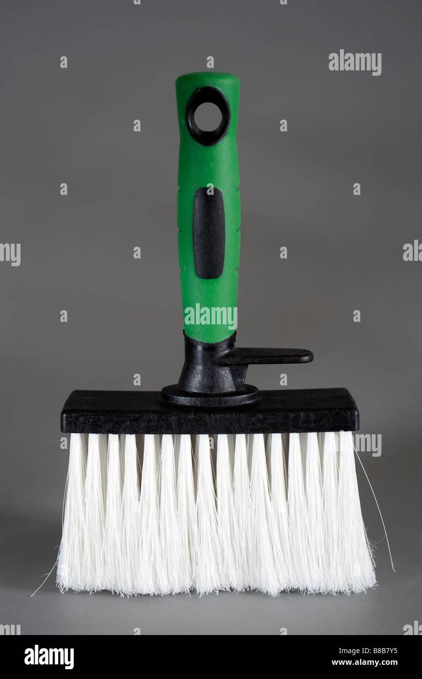 Green and black handled paste brush - Stock Image