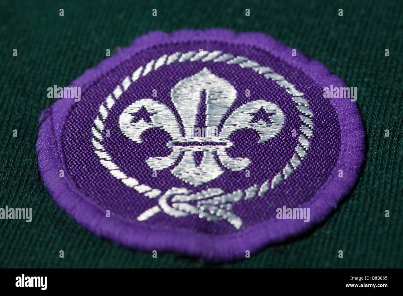 Close up of Cub Scout bagde on green jersey - Stock Image