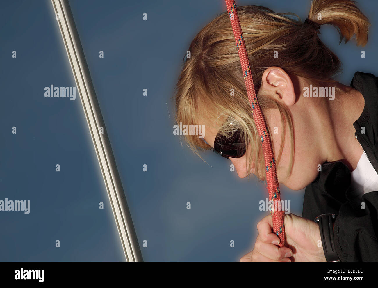 profile of white european female onboard a yacht. - Stock Image