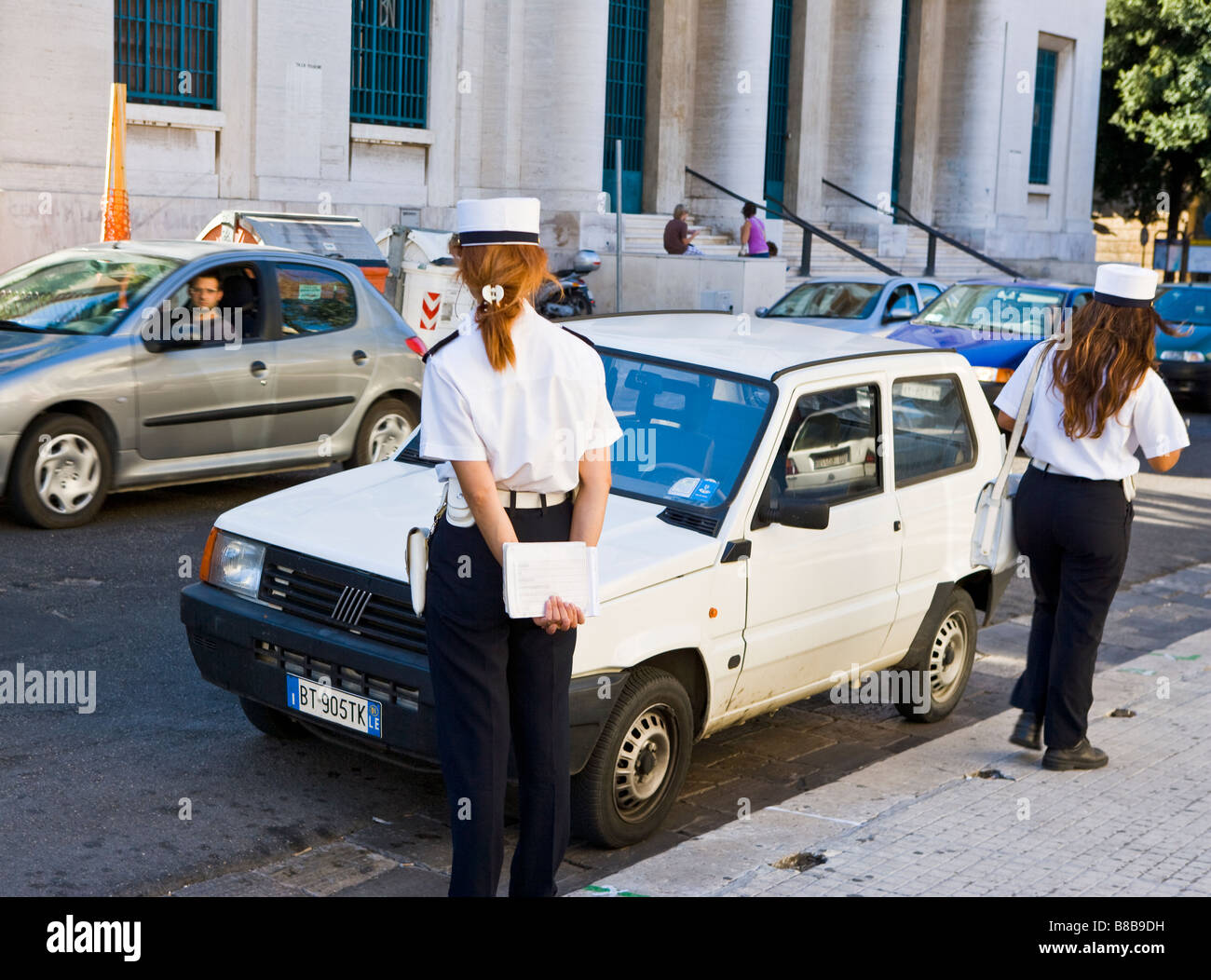 Two female Polizia enforcing parking regulations Lecce Puglia Italy - Stock Image