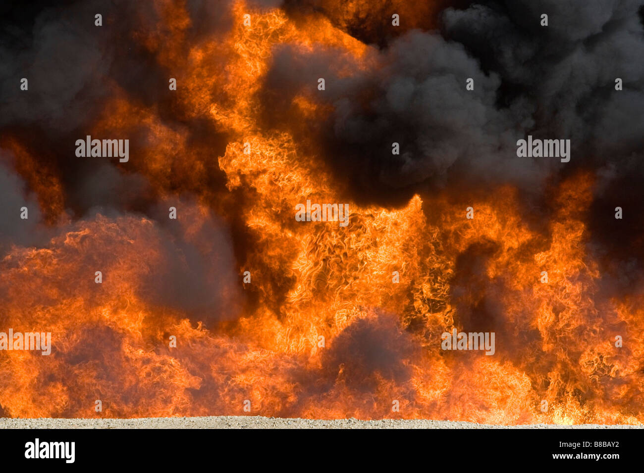 Jet fuel fire at an airport firefigher training facility in Boise Idaho USA - Stock Image