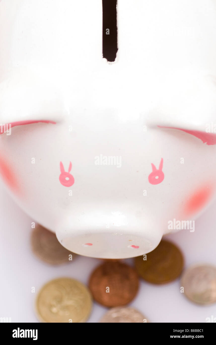 Close up of a piggy bank with coins - Stock Image