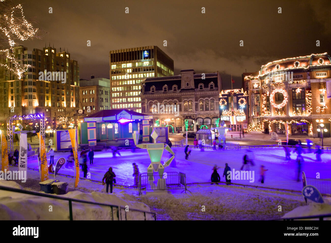 People ice skating at Place Hydro Quebec fronting Capitole Theater Winter Carnival Quebec City canada - Stock Image