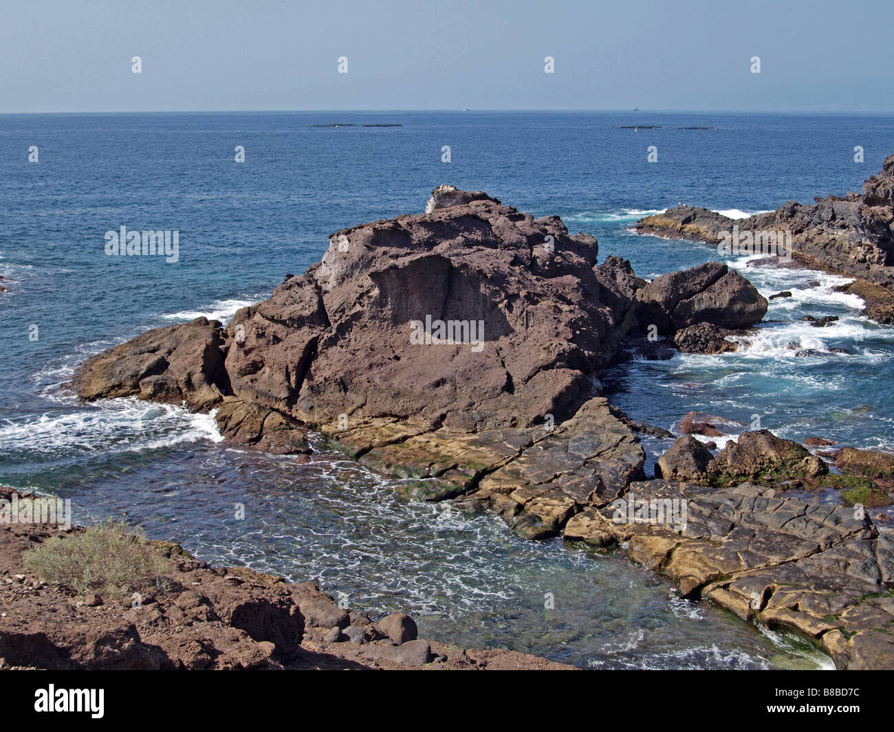 Sea braking on the volcanic rock coastline in Tenerife. - Stock Image