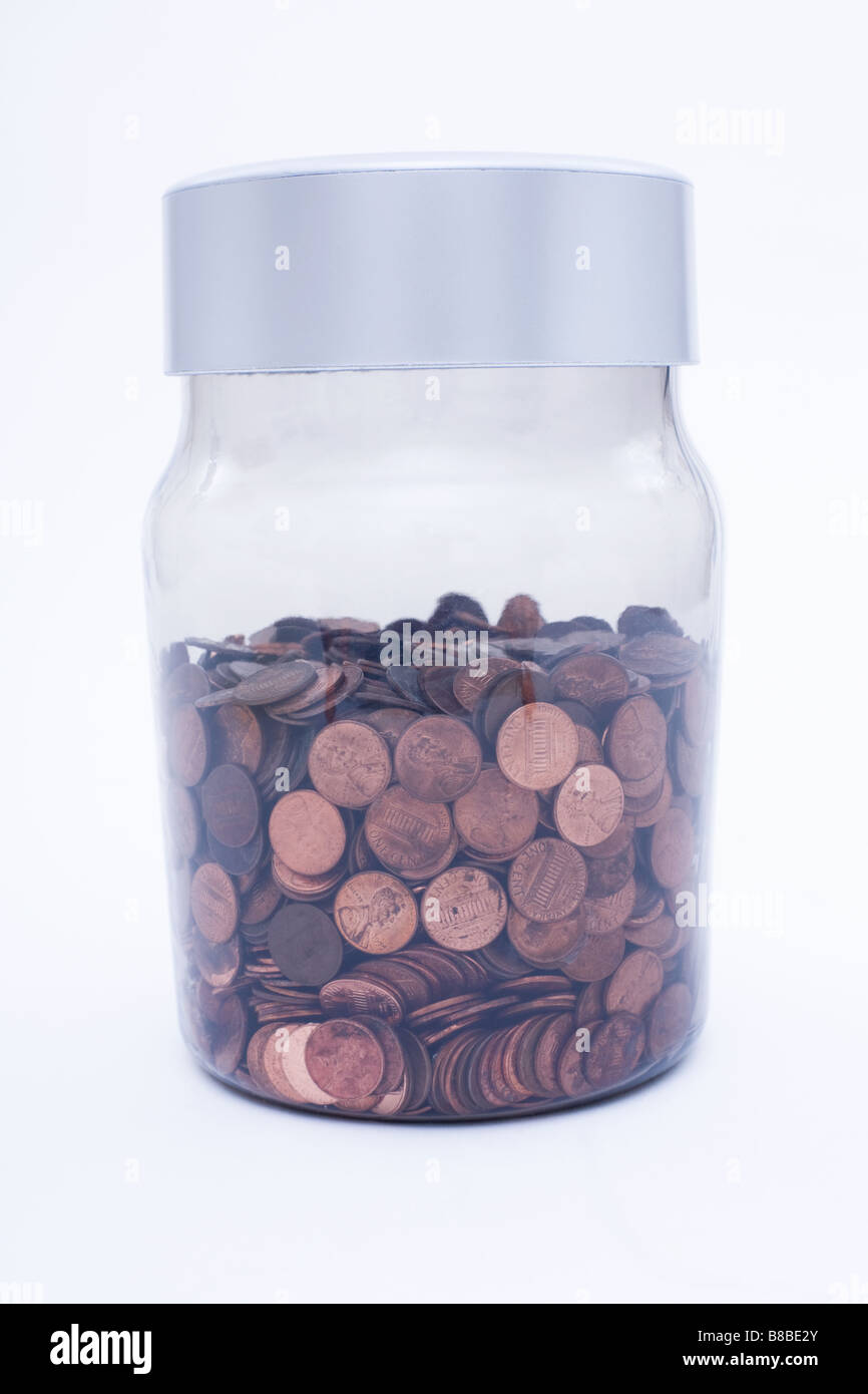A jar of American pennies (cents) - Stock Image