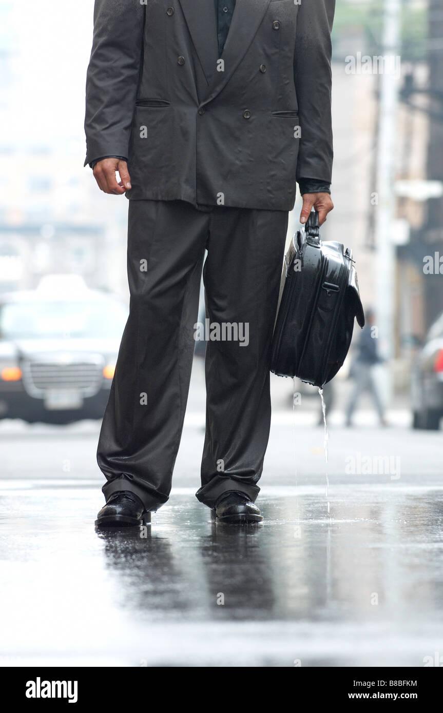 Business Man Computer Bag Standing  Rain, Toronto,Ontario - Stock Image