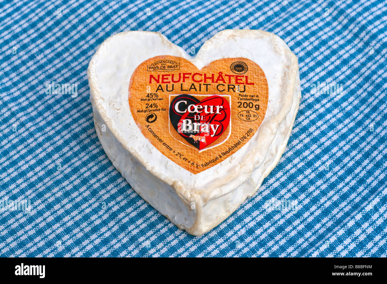 French heart shaped Neufchatel / Normandy fresh soft cheese on linen cloth. - Stock Image