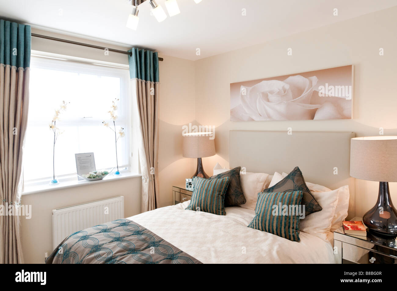 Show bedroom in a George Wimpey new build apartment London England UK - Stock Image