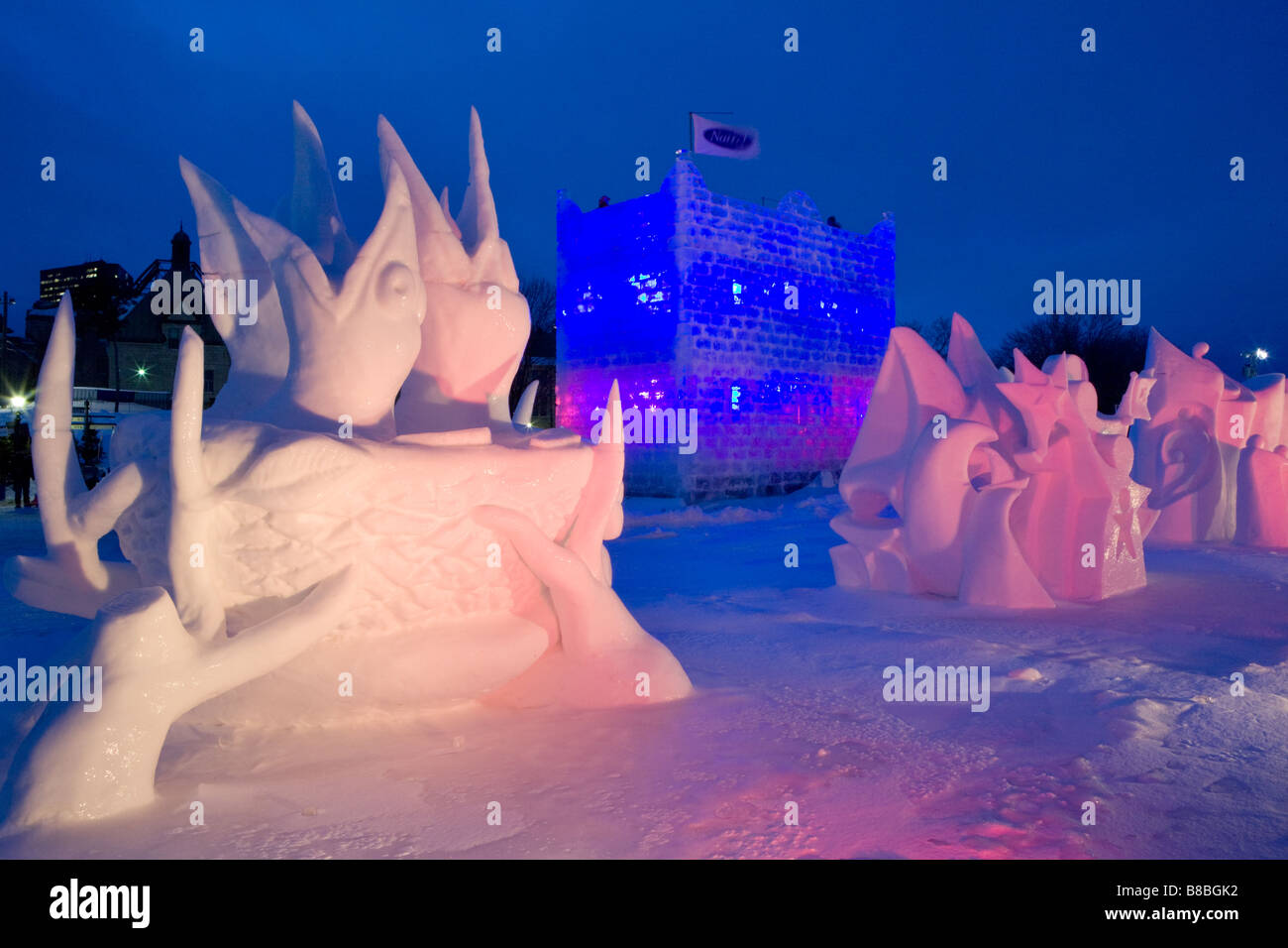 Snow sculptures and Natrel ice tower on Plains of Abraham Winter Carnival Quebec City - Stock Image