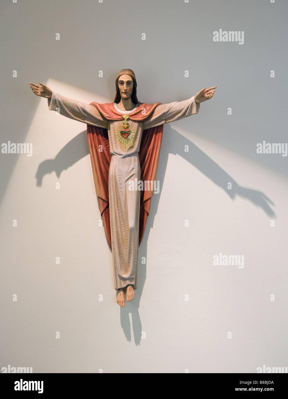 Jesus Christ statue on wall - Stock Image