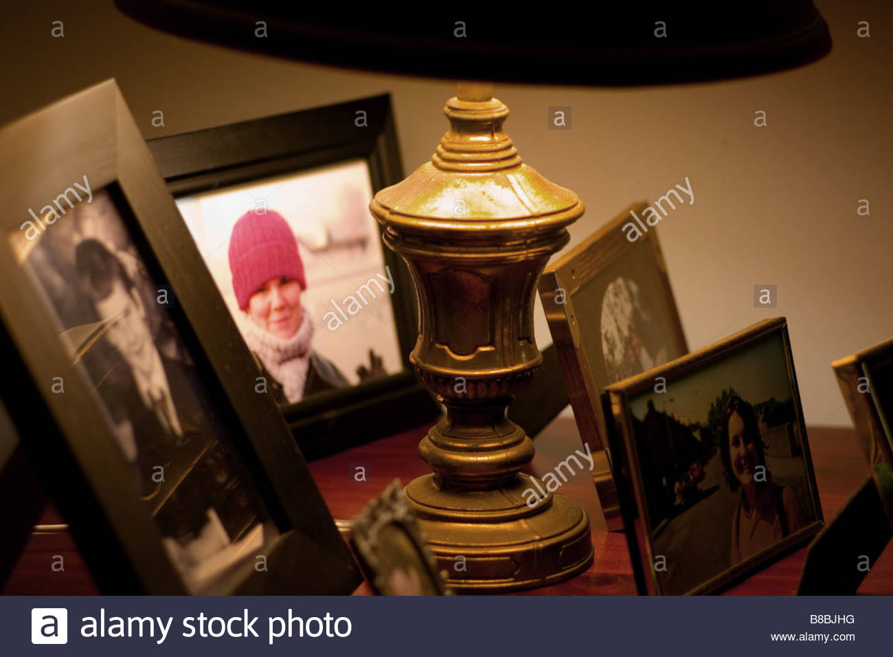 A display of family photos. - Stock Image
