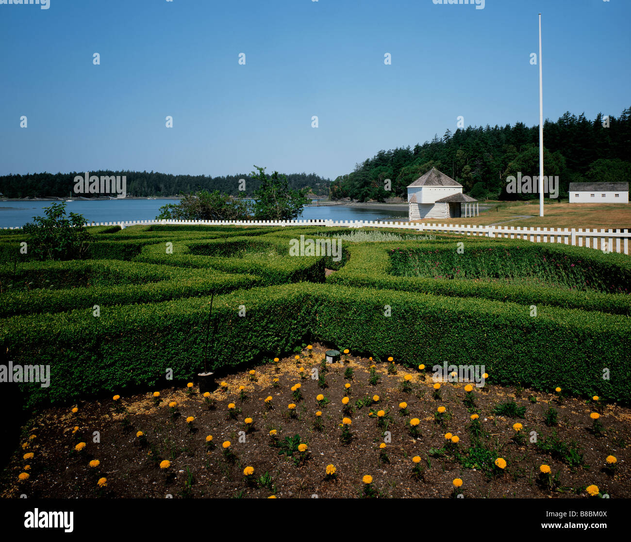 WASHINGTON - Formal garden and Block House at English Camp in San Juan Island National Historical Park on Garrison - Stock Image