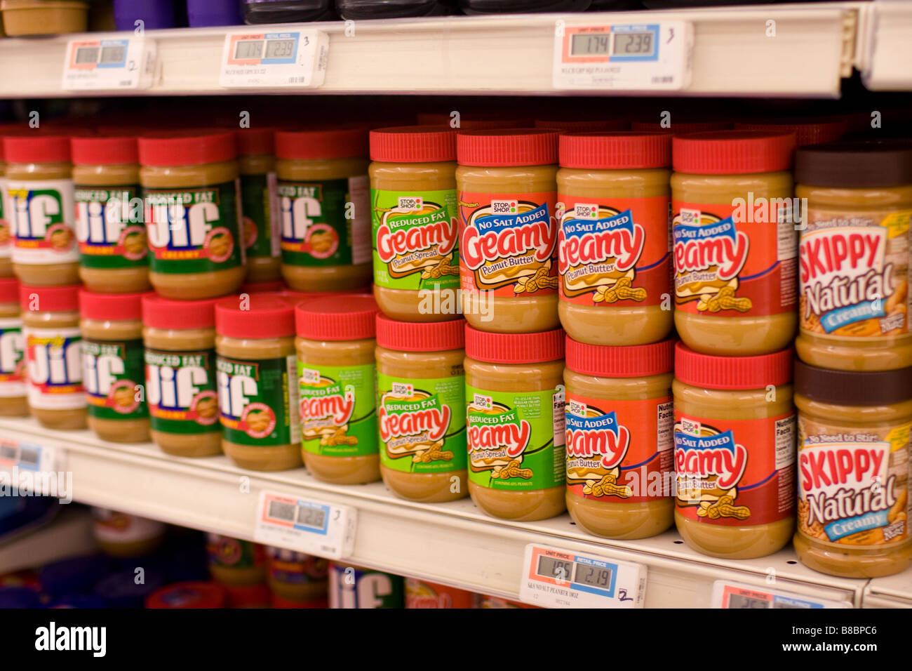 Peanut butter jars for sale on a supermarket shelve in the USA. Peanut butter sales have dropped after a salmonella - Stock Image