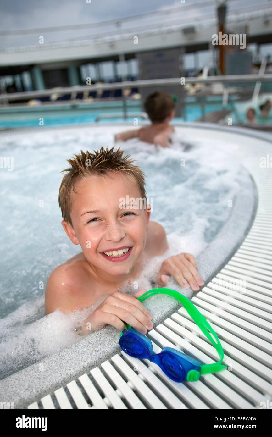 Boy  Edge  Hot Tub Cruise Ship - Stock Image
