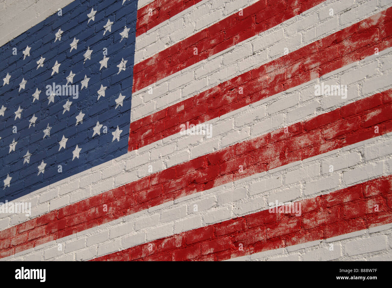 American Flag in faded paint on exterior wall - Stock Image