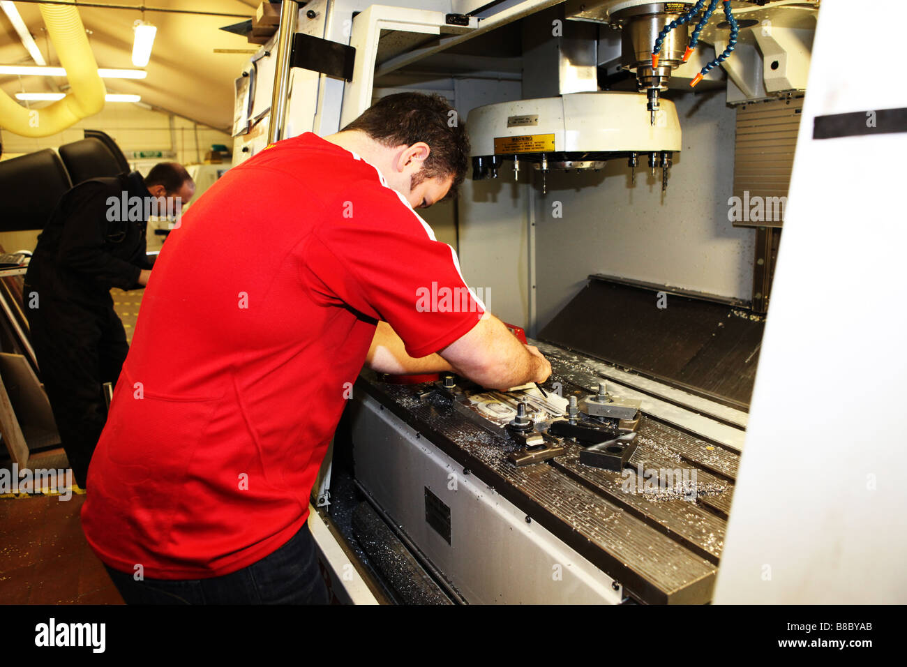 Skilled Workers Machine Operators Using A Precision Metal Working Lathe To  Produce Parts For Hand Made