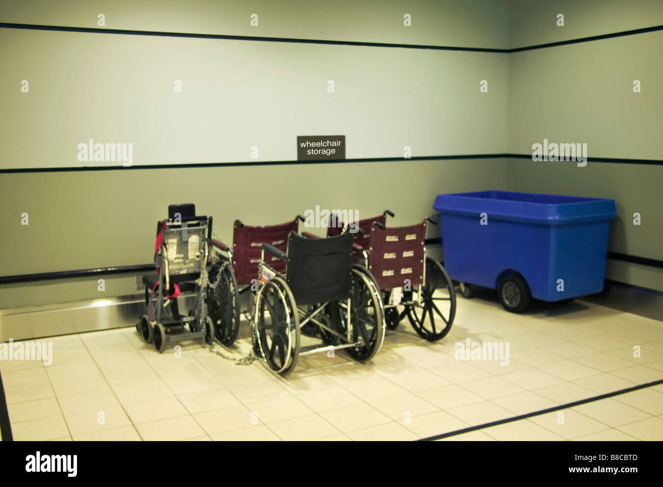 Wheelchair Storage Corner an Airport - Stock Image