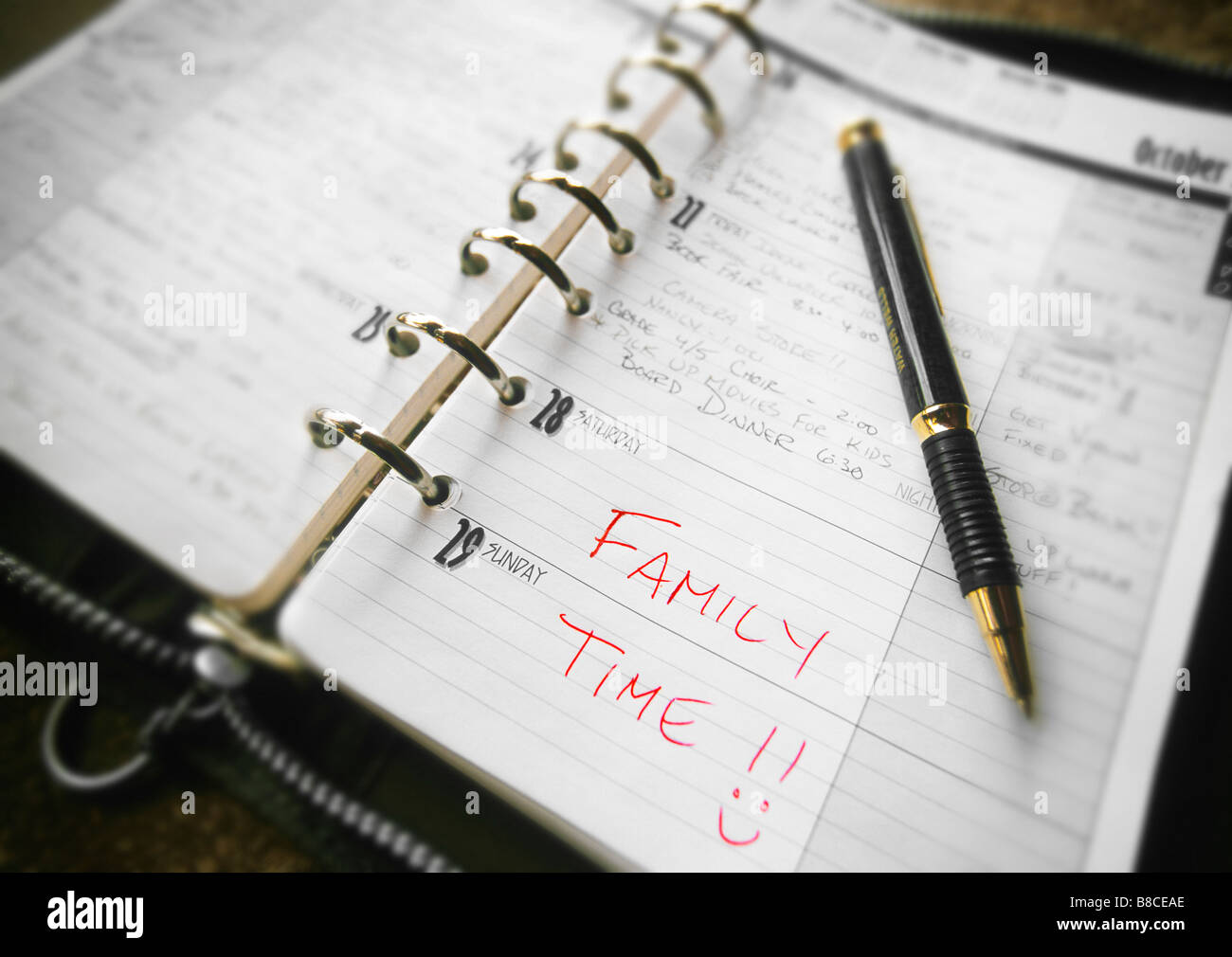 FL6267, Natural Moments Photography; Family Time Scheduled into Dayplanner - Stock Image