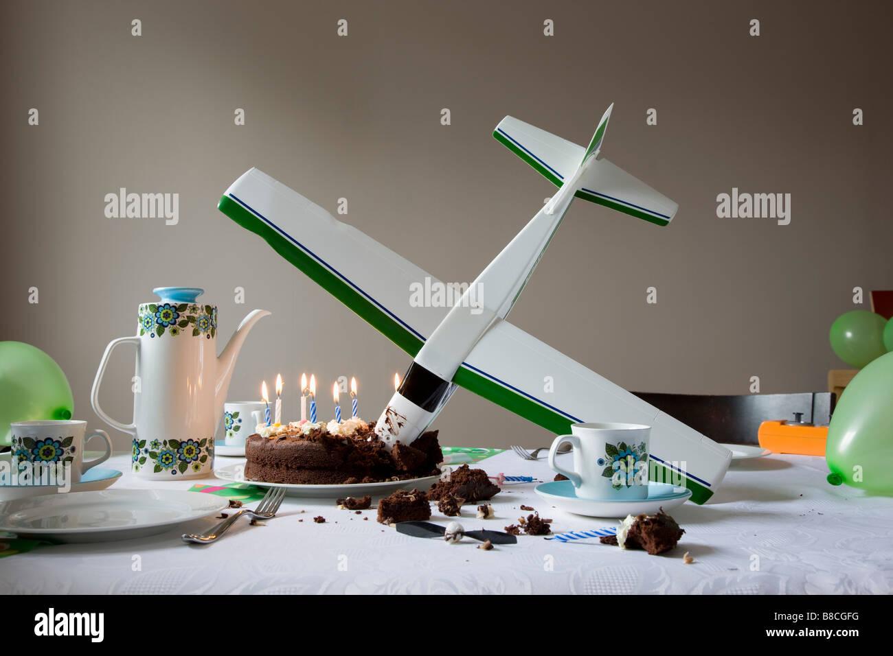 Model Airplane Flown Into Birthday Cake Stock Photo 22404020 Alamy
