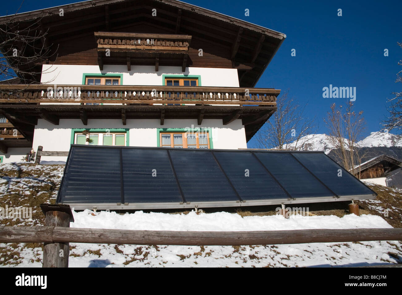 Pinzgau Region Austria EU January Solar Panels in the garden to provide cheap energy Stock Photo