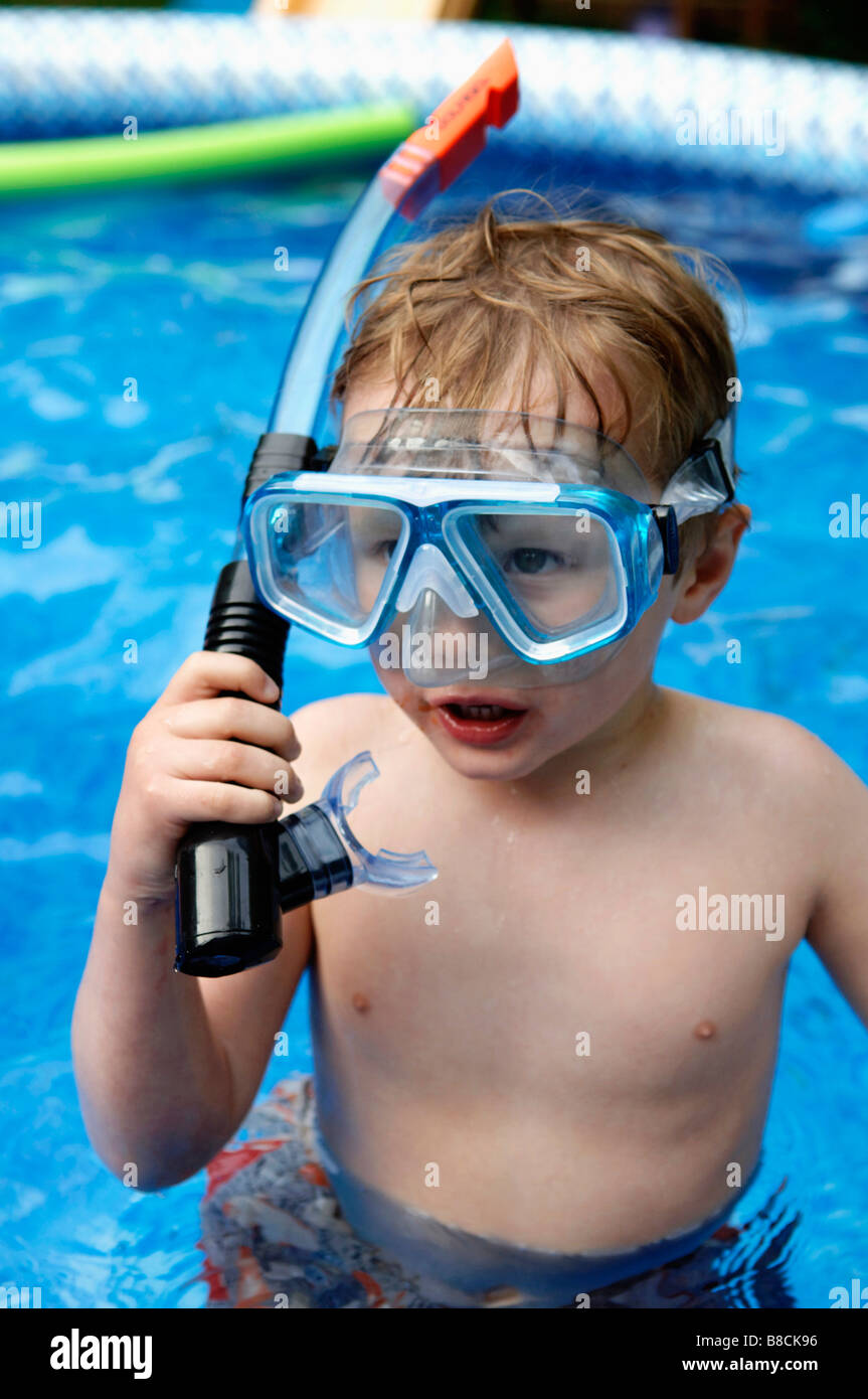 Young Boy, 4 years old, Snorkel  Swimming Pool - Stock Image