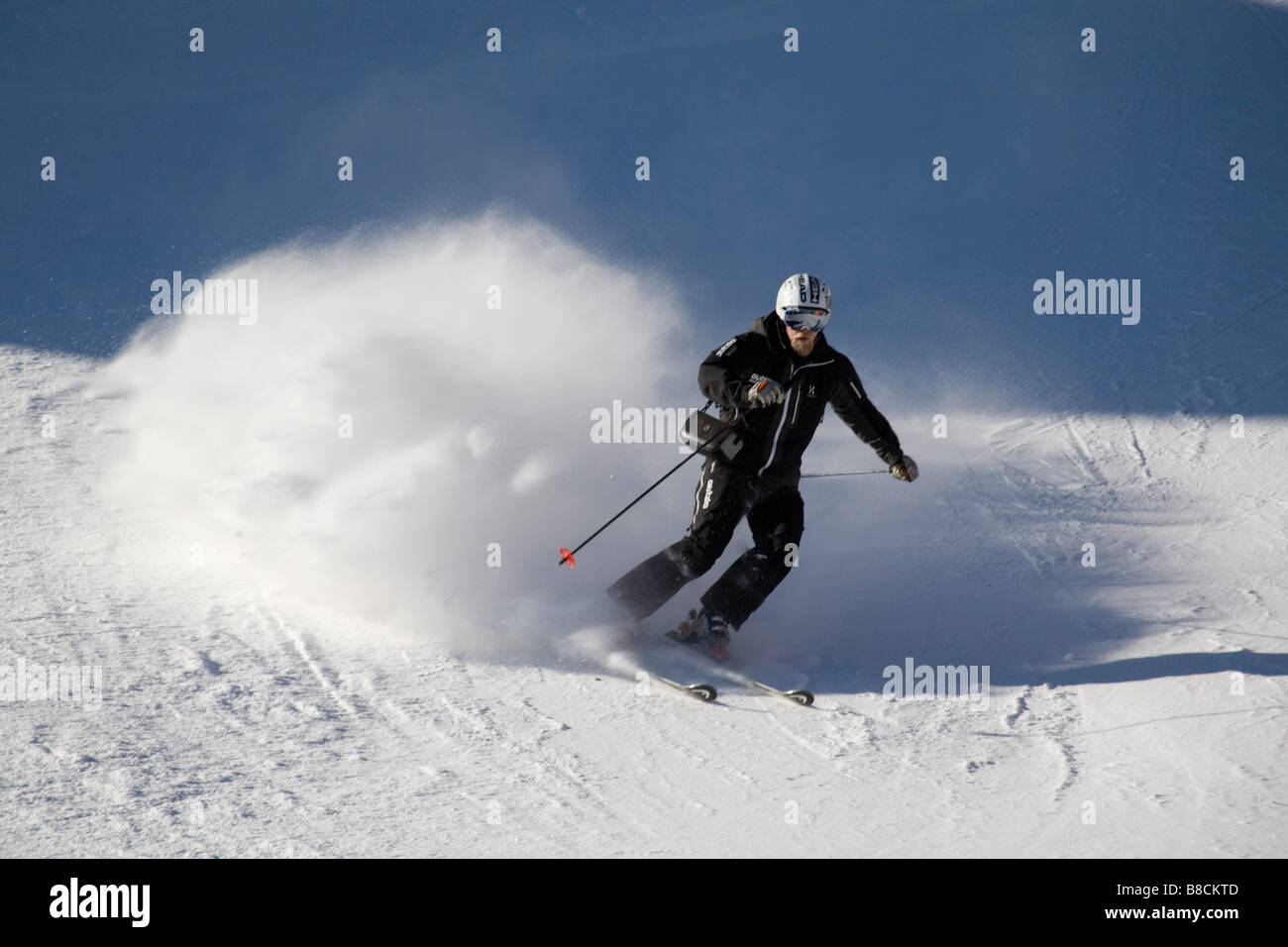 Austria EU January A bearded skier in a black ski suit on the piste - Stock Image