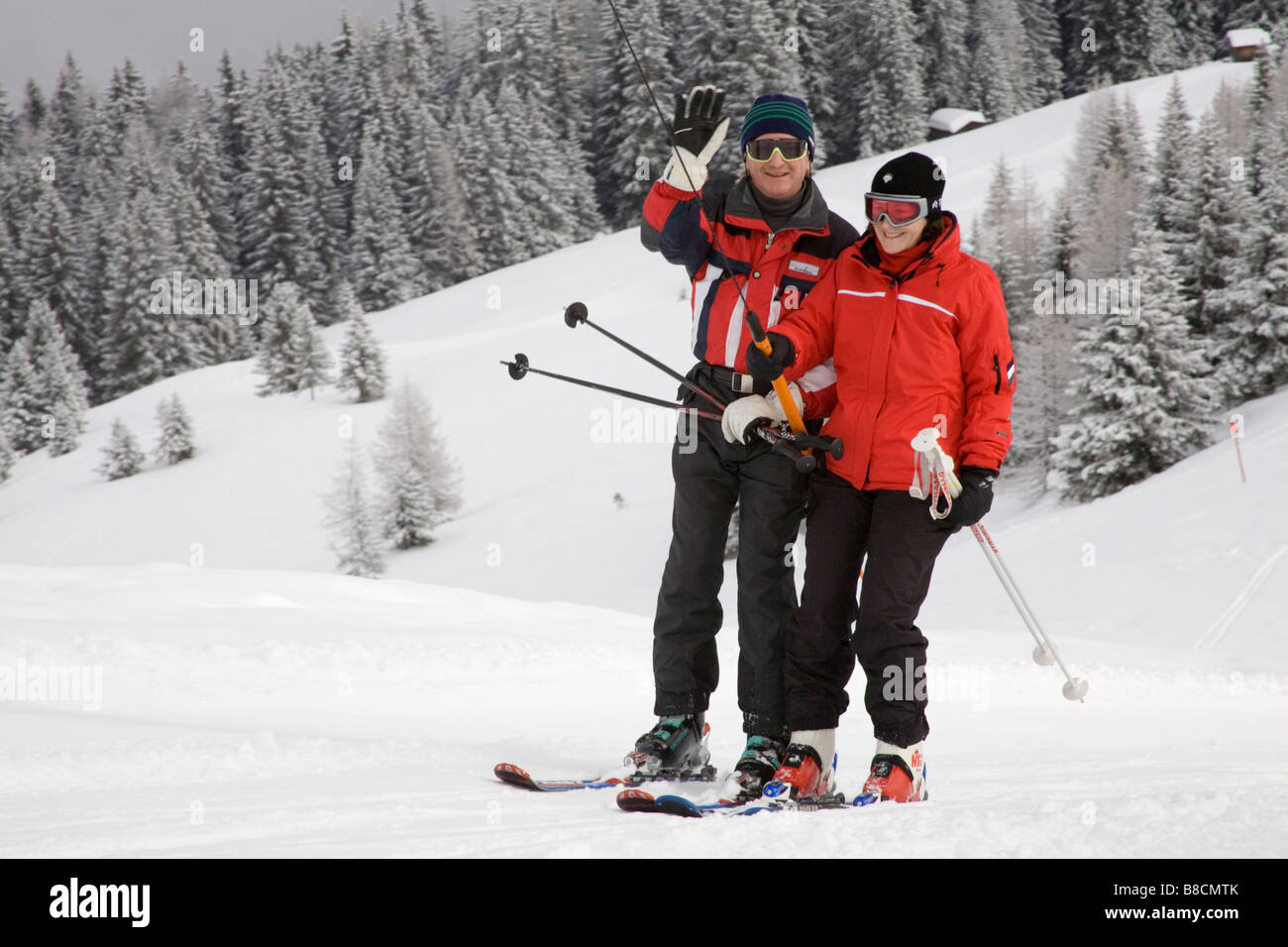 Rauris Austria EU January An older man and woman in red ski jackets  ascending to the 845afd9df