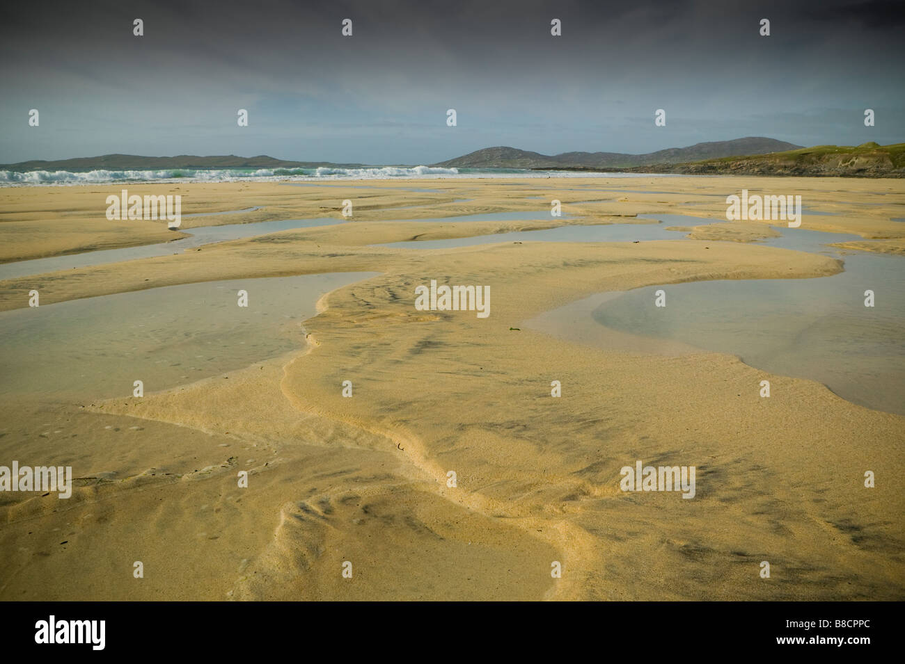 Outer Hebrides Island Harris beach at low tide sand sea and rocks coast shore line in Scotland - Stock Image