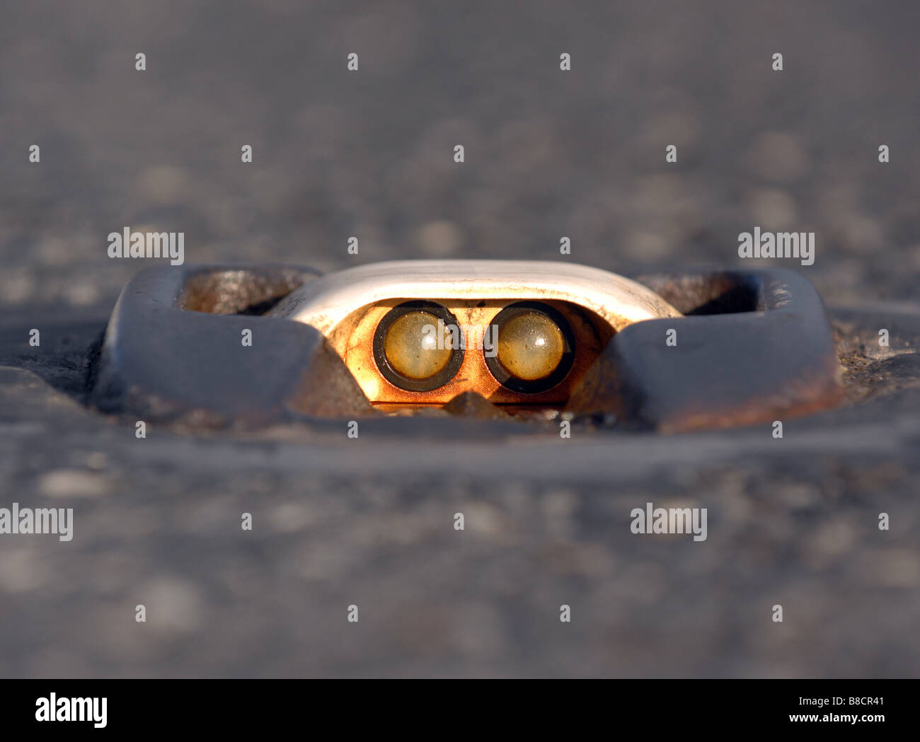 A catseye in the centre of the road - Stock Image