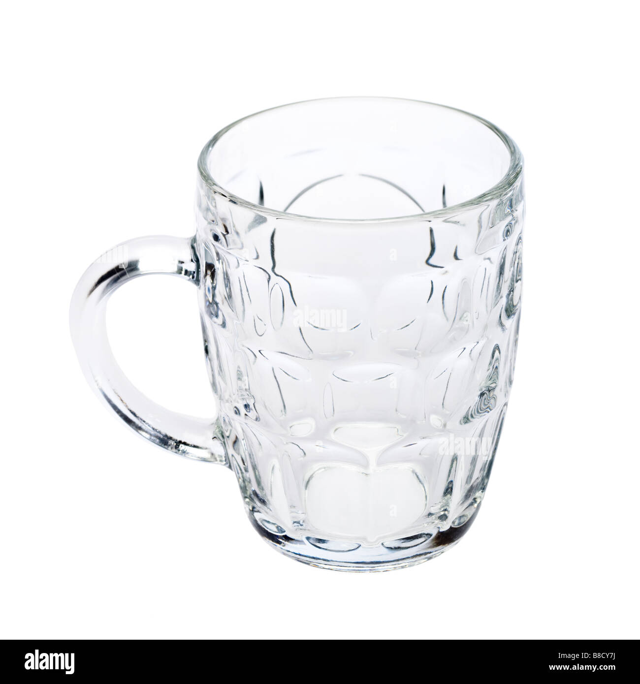 Empty Traditional British Ale Jug beer glass on white Stock Photo
