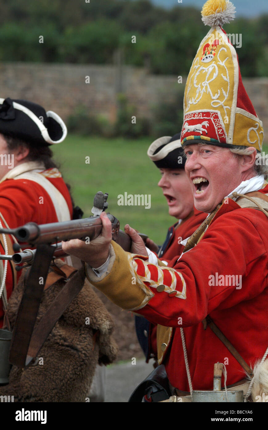 Redcoat soldiers charging their bayonets at the 2008 re-enactment of the Battle of Prestonpans, Scotland. Stock Photo