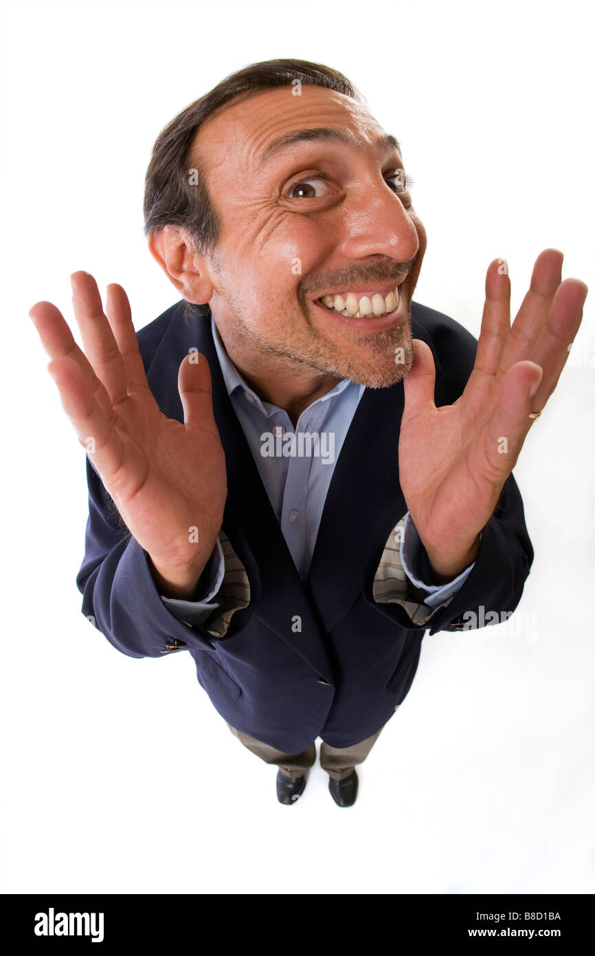 Fish eye lens of a business man with a silly facial expression - Stock Image