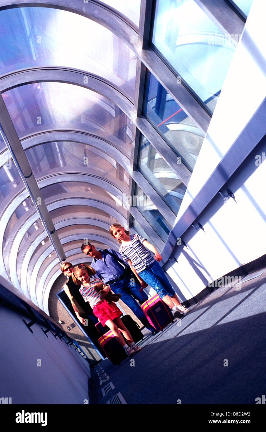 FV3144, Mad Cow Studio; Family  4 Airport Walkway - Stock Image