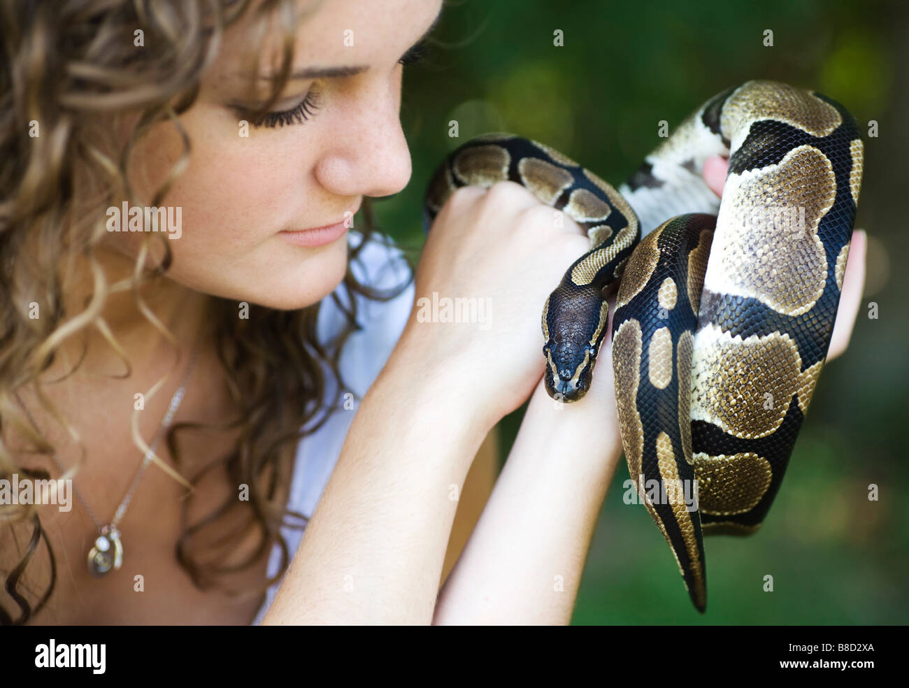 Woman with a snake - Stock Image