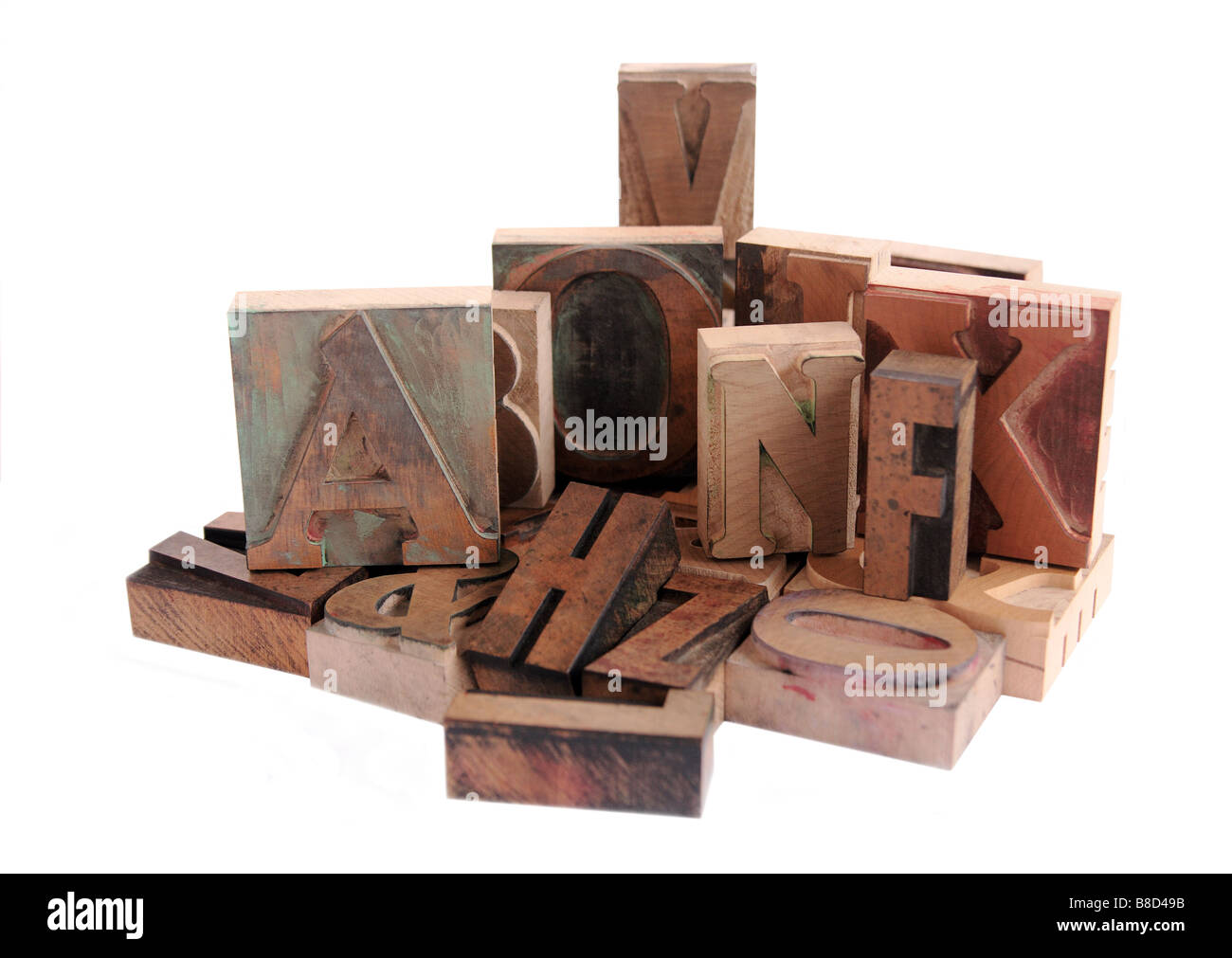 an arrangement of letterpress wood letters in various fonts - Stock Image