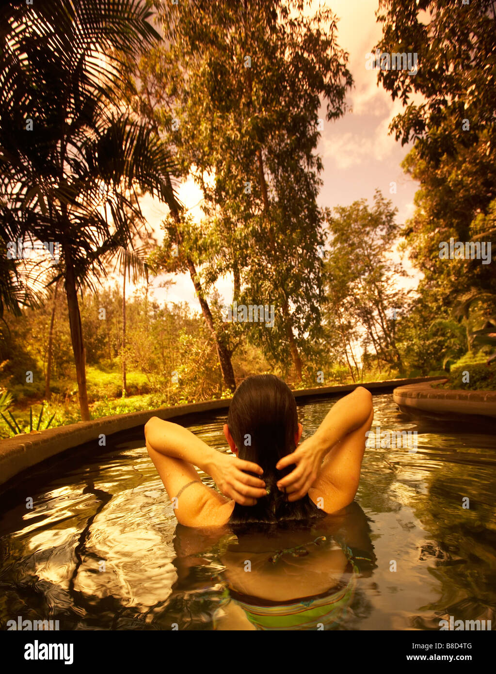 Woman Relaxing Hot Pool   Blancaneaux Lodge, San Ignacio, Belize - Stock Image