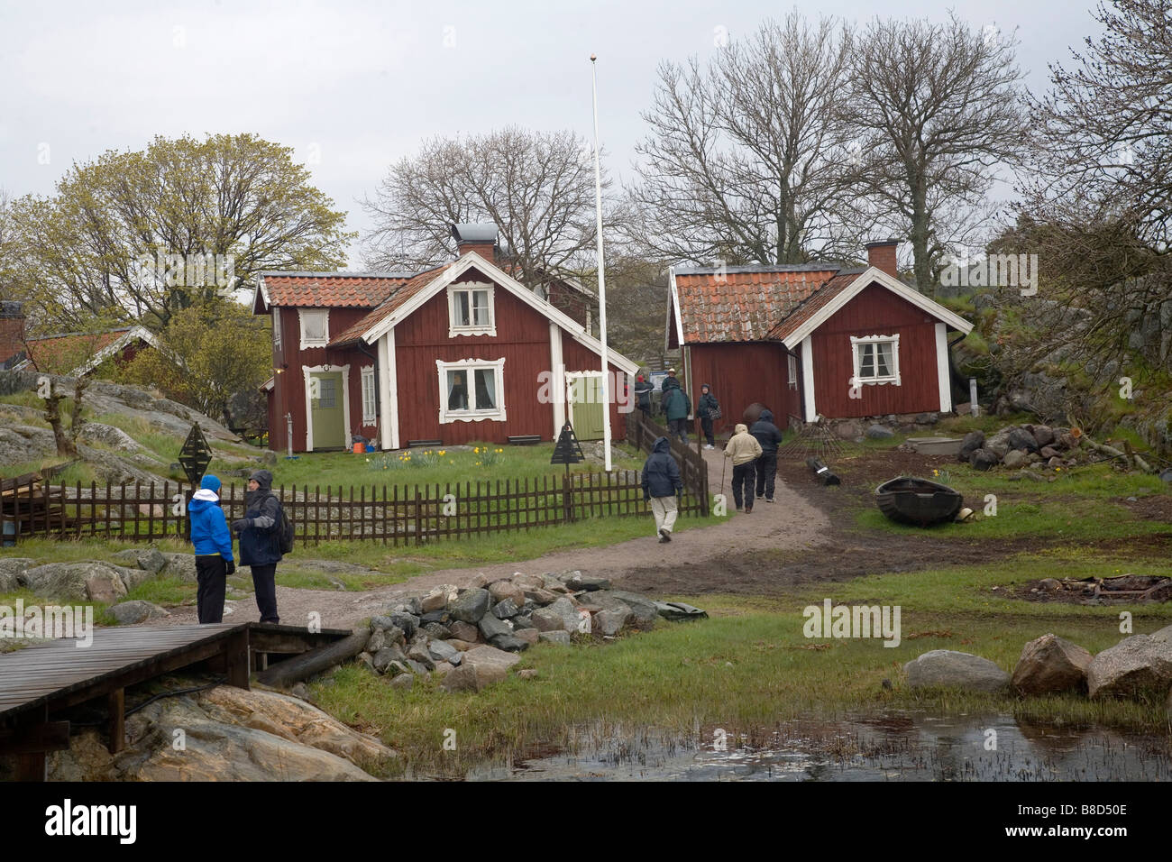 American tourists at Bullero Island at Swedish Archipelago Sweden Baltic Sea - Stock Image