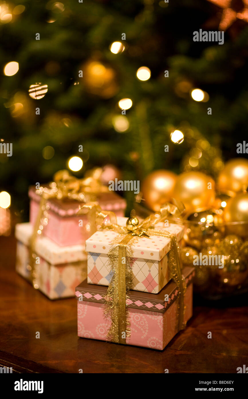 Wrapped Christmas Gifts Decorated Tree - Stock Image