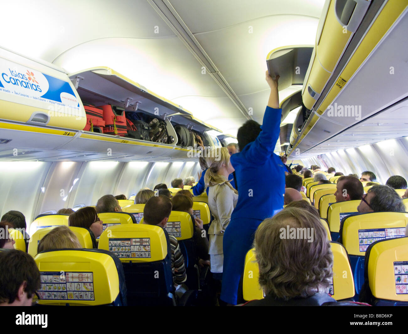 Salon of airplane with passengers ready for take off. Editorial use only. - Stock Image